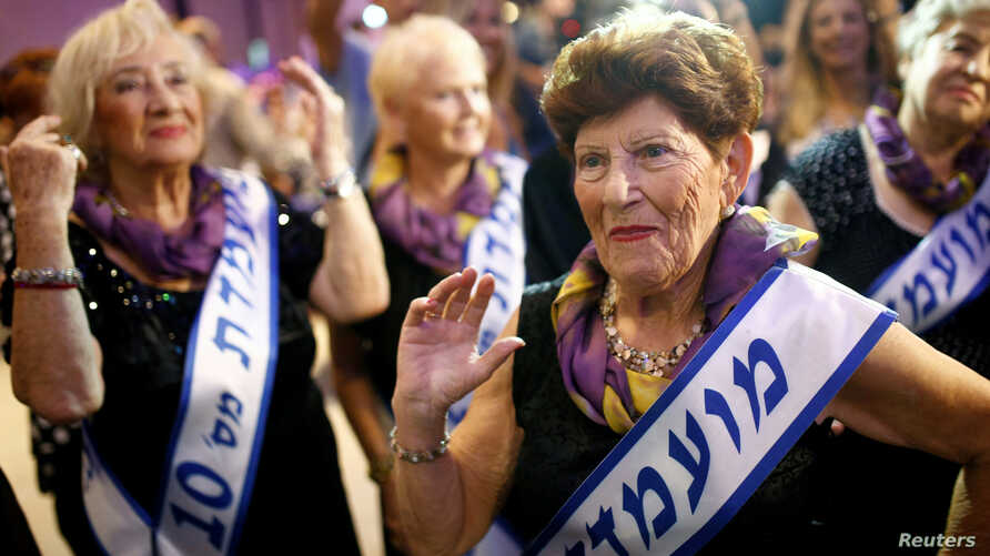 Holocaust survivor Carmela Ben Yehuda, 89, dances during the annual Holocaust survivors' beauty pageant in the Israeli city of Haifa, Oct. 30, 2016.