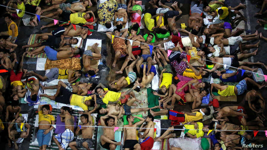 FILE -  Inmates sleep in the open at Quezon City Jail in Manila, Philippines, Nov. 5, 2016.