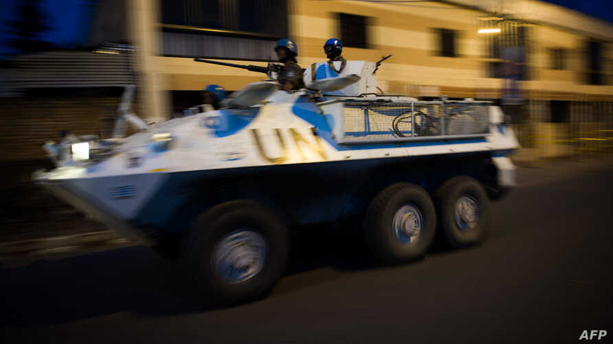 A United Nations armored personnel carrier patrols through the city of Goma following the sound of shell fire and gunshots on November 19, 2012.