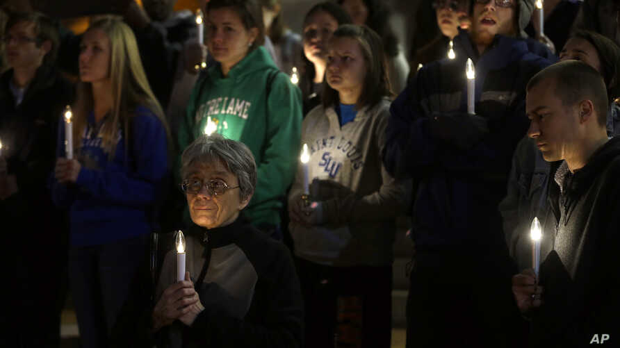 A small group of death penalty opponents stand outside St. Francis Xavier Church during a vigil in protest of the scheduled execution of Missouri death row inmate Joseph Paul Franklin, Nov. 19, 2013, in St. Louis.