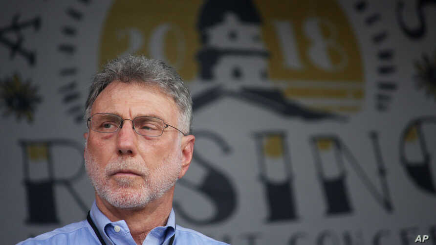 Martin Baron, executive editor of The Washington Post, stands on stage during a benefit concert in Annapolis, Md., on Saturday, July 28, 2018, to honor the Capital Gazette employees killed in a shooting at their newsroom in June.