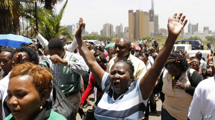 Striking public health workers participate in a demonstration as they enter the Ministry of Health headquarters in Kenya's capital Nairobi, March 9, 2012.