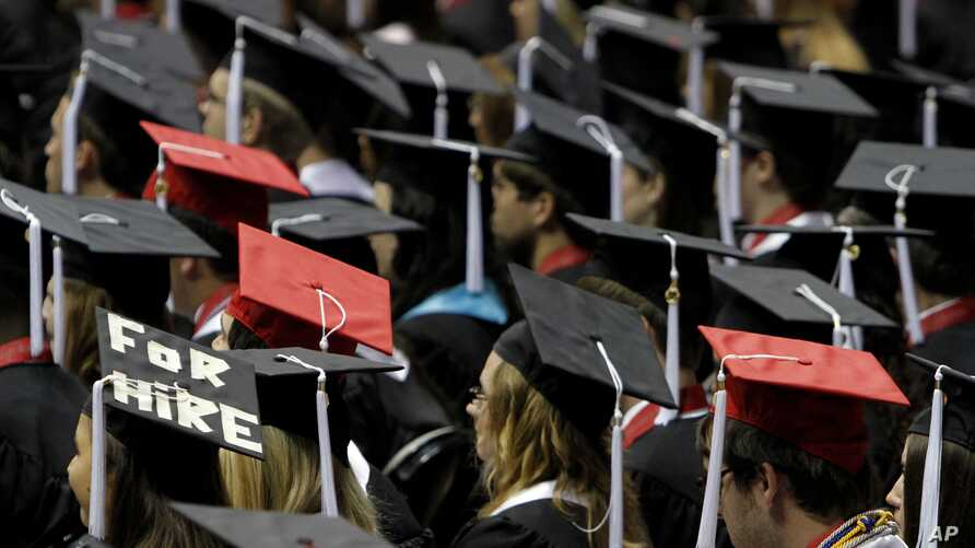 In this Saturday, Aug. 6, 2011 file picture, students attend graduation ceremonies at the University of Alabama in Tuscaloosa, Ala.  (AP Photo/Butch Dill)