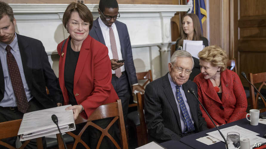 Senate Judiciary Committee member Sen. Amy Klobuchar, D-Minn.(L) which considers judicial nominations, joins Senate Minority Leader Harry Reid of Nev. (C) and Sen. Debbie Stabenow, D-Mich., at a meeting on Capitol Hill in Washington, , April 6, 2016,