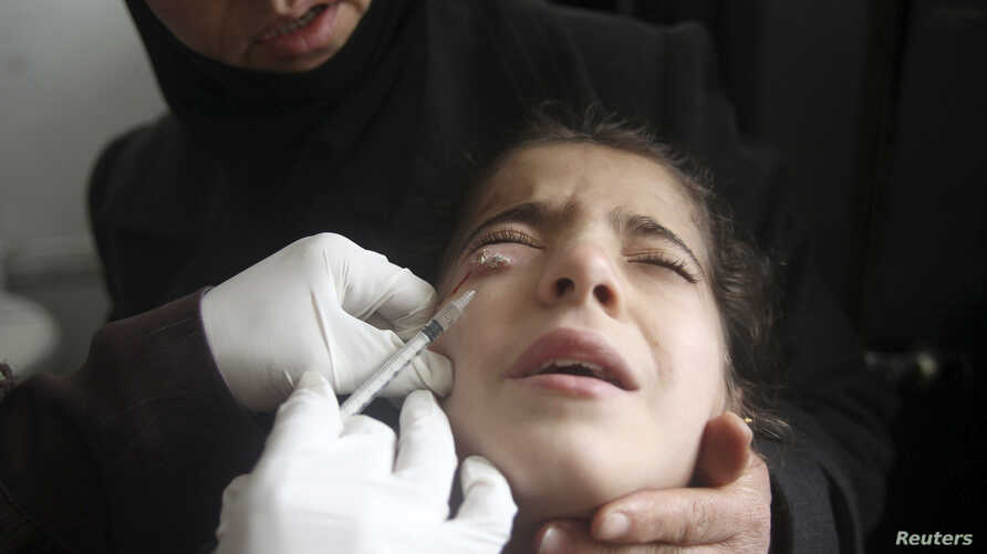 A doctor treats a child showing symptoms of leishmaniasis at a hospital in Aleppo, February 11, 2013. Doctors in Aleppo and Deir al-Zor have reported outbreaks of leishmaniasis, an endemic tropical disease transmitted by sand-flies that causes skin u