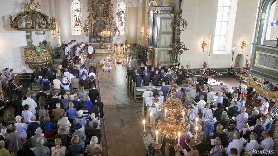 FILE - A memorial service is held at Oslo Cathedral, as Norway marked the fourth anniversary of the 2011 attacks, in Oslo, July 22, 2015.