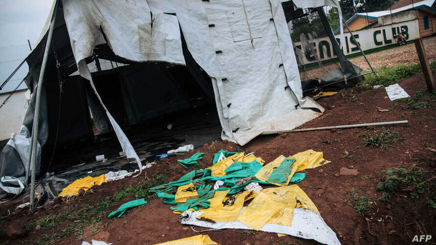 A picture taken on Dec. 27, 2018 shows protective equipments for Ebola care left on the ground next to ransacked tents by demonstrators at the Ebola transit center in Beni, DR Congo.
