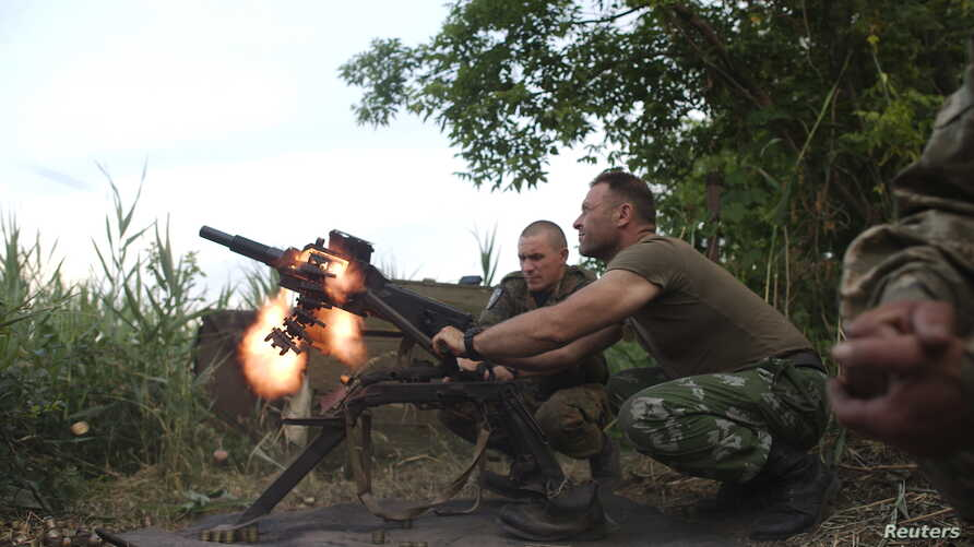 FILE - Members of the Ukrainian armed forces fire a grenade launcher, in response to what servicemen said were shots fired from the positions of fighters of the separatist self-proclaimed Donetsk People's Republic, in the town of Avdiivka, Donetsk re