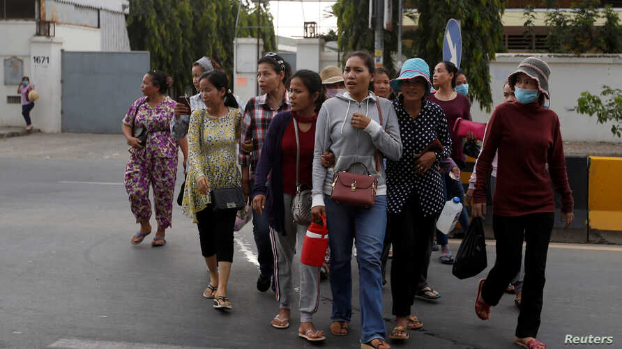 Garment workers leave for home after work at a factory, on the outskirts of Phnom Penh, Cambodia, Oct. 16, 2018.