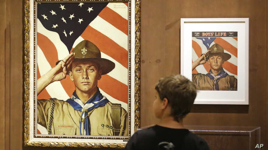 FILE - An 11-year-old boy looks over a Boy Scout-themed Norman Rockwell exhibition at the Church History Museum in Salt Lake City, Utah, July 22, 2013..