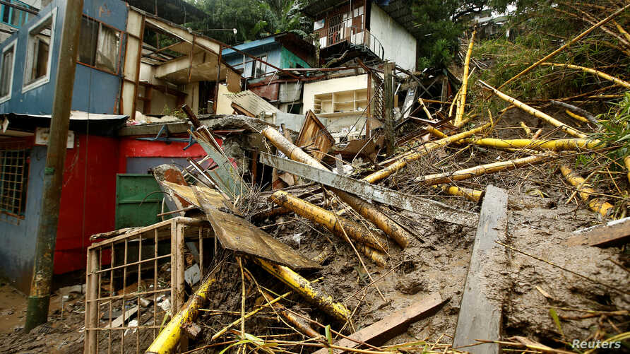 Houses damaged by a mudslide are seen during heavy rains of Tropical Storm Nate that affects the country in San Jose, Costa Rica, Oct. 5, 2017.