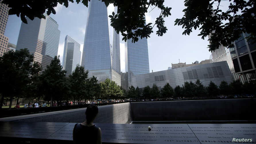 A single white rose is left at the edge of the South Pool of the 911 Memorial atop the area of the memorial for New York City Police (NYPD) officers killed in the 2001 attacks on the World Trade Center, in Manhattan, New York, U.S., July 8, 2016.