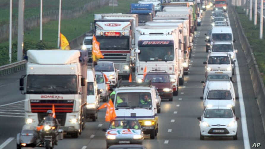 Truck drivers slown down traffic on highway A1 near Lille, northern France, as they demonstrate against the government's pension reform, 18 Oct 2010
