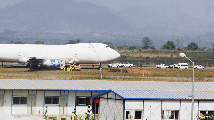 Officials inspect a Saudi Air Boeing 747 cargo aircraft after it overran the runway crashing into a tanker truck at the Nnamdi Azikiwe International Airport in Abuja, Dec. 5, 2013.