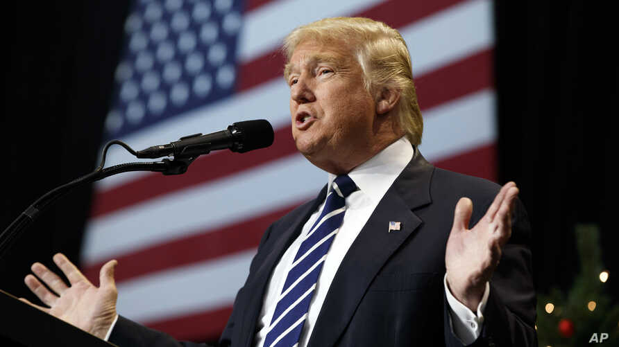 FILE - President-elect Donald Trump speaks during a rally at the Wisconsin State Fair Exposition Center in West Allis, Wis., Dec. 13, 2016.