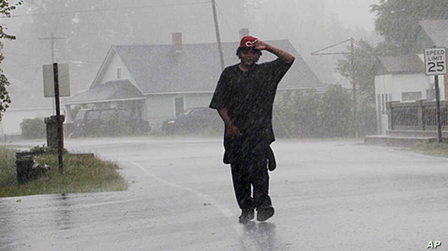 Antoine White walks in the effects of Hurricane Irene in Elizabeth City, North Carolina, August 27, 2011 as the storm moves up the coast