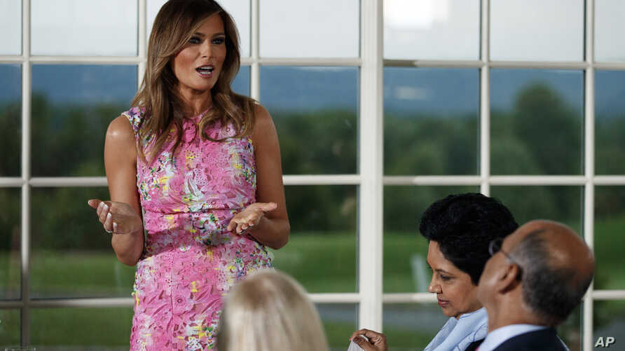 First lady Melania Trump speaks during a dinner meeting with President Donald Trump and business leader in Bedminster, N.J.