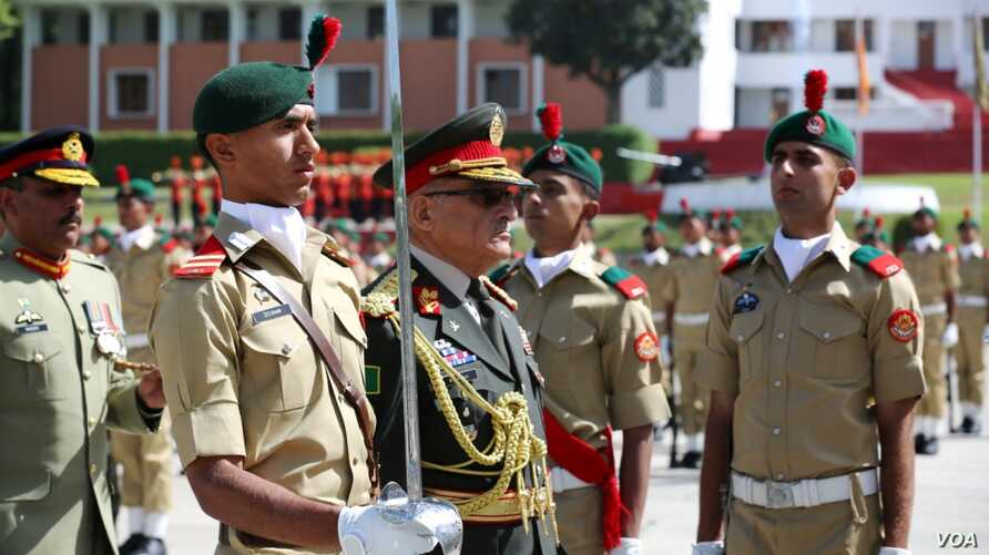 General Sher Mohammad Karimi, Afghan Army Chief of General Staff who was chief guest at passing out parade at Pakistan Military Academy, Kakul reviewing the parade, April 18, 2015. (Pakistan Army picture)