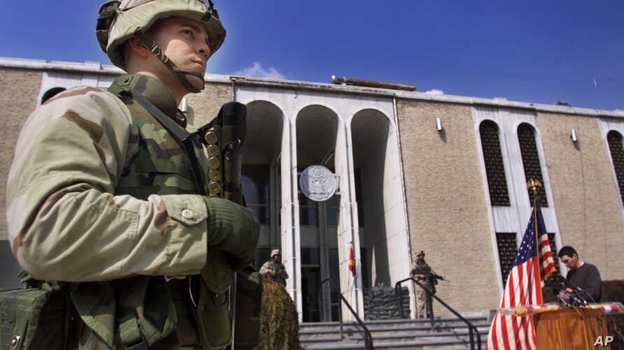 FILE - US marine guards entrance of American embassy in Kabul, Afghanistan.