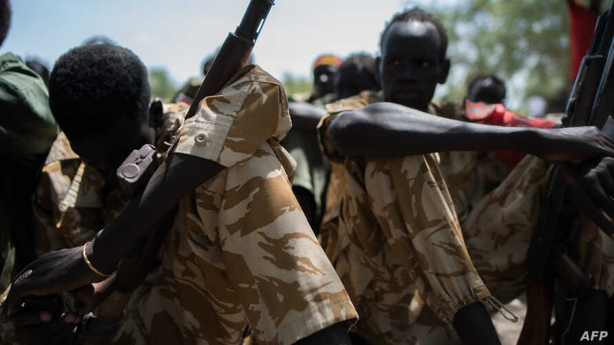 Child soldiers listen to a speech after being released from a group called the Cobra Faction and from the main SPLA/IO rebel faction during a ceremony in Tenet, near Pibor, South Sudan, Oct. 26, 2016.
