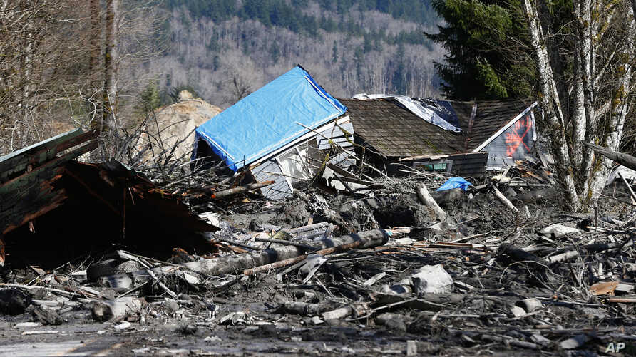 A house is seen destroyed in the mud on Highway 530 next to mile marker 37 on Sunday, March 23, 2014.