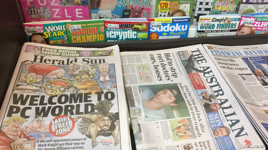 A newspaper stand displays the Herald Sun newspaper, featuring a controversial cartoon of Serena Williams, in Melbourne, Sept. 12, 2018.