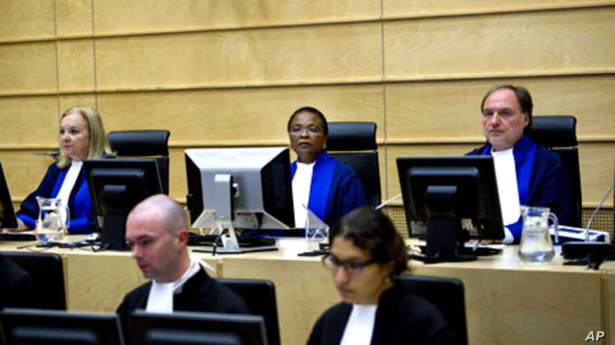 Judges Sylvia Steiner, Sanji Mmasenono Monageng, and Cuno Tarfusser, back row, from left, are seen in the courtroom in The Hague, Netherlands. The International Criminal Court (ICC) has issued arrest warrants for Libyan leader Moammar Gadhafi, his so