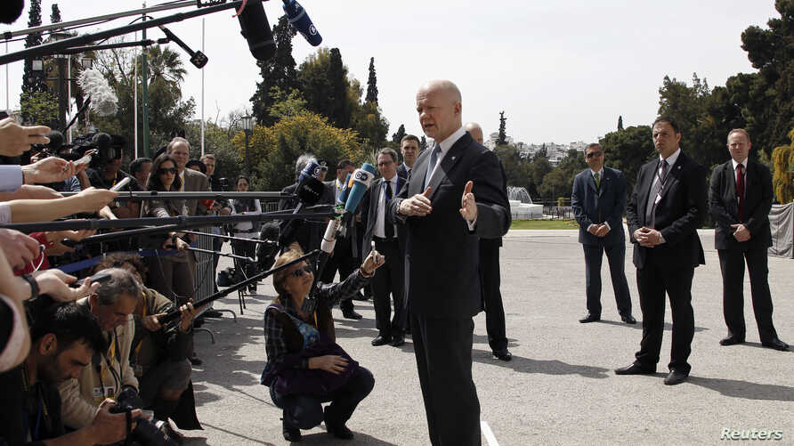 Britain's Foreign Secretary William Hague speaks to journalists during an informal meeting of EU foreign ministers in Athens April 4, 2014.