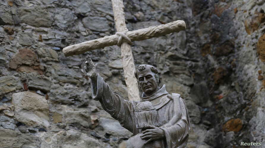 A statue of Father Junipero Serra stands at Mission San Juan Capistrano in California. Pope Francis will confer sainthood on the controversial 18th century Spanish missionary during his visit to Washington, Sept. 23, 2015.