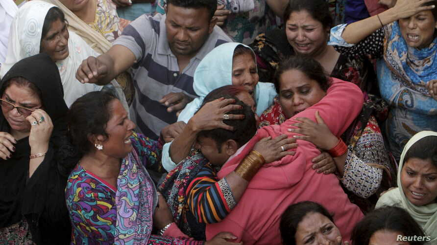Family members mourn the death of a relative, who was killed in a blast outside a public park on Sunday, during funeral in Lahore, Pakistan, March 28, 2016.