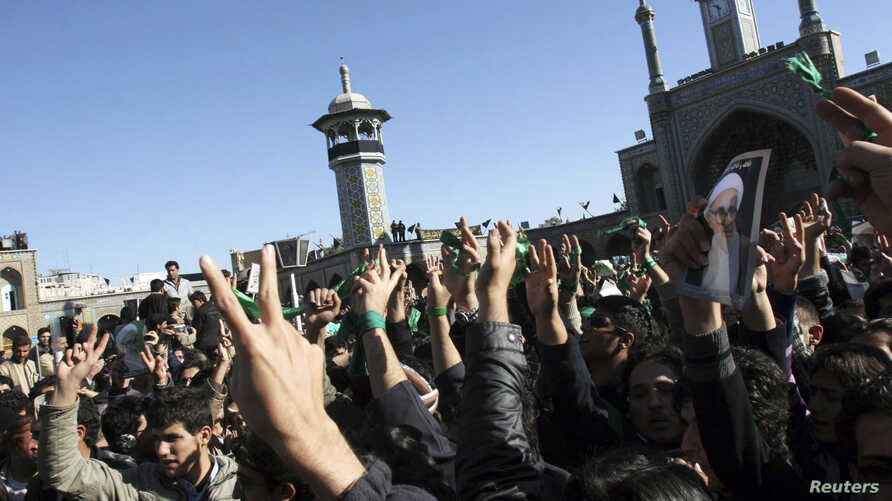 FILE - Supporters of the Iranian opposition movement wear green during the funeral of Grand Ayatollah Hossein Ali Montazeri in the holy city of Qom Dec. 21, 2009.