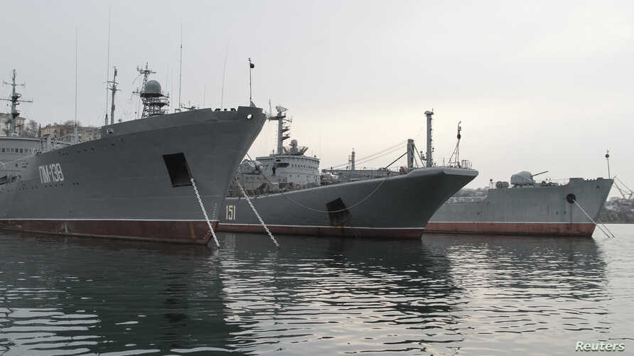 """Russia's Large Landing Ship """"Azov"""" (C) is pictured moored at the home base of Russia's Black Sea Fleet in the Crimean port of Sevastopol February 24, 2014"""