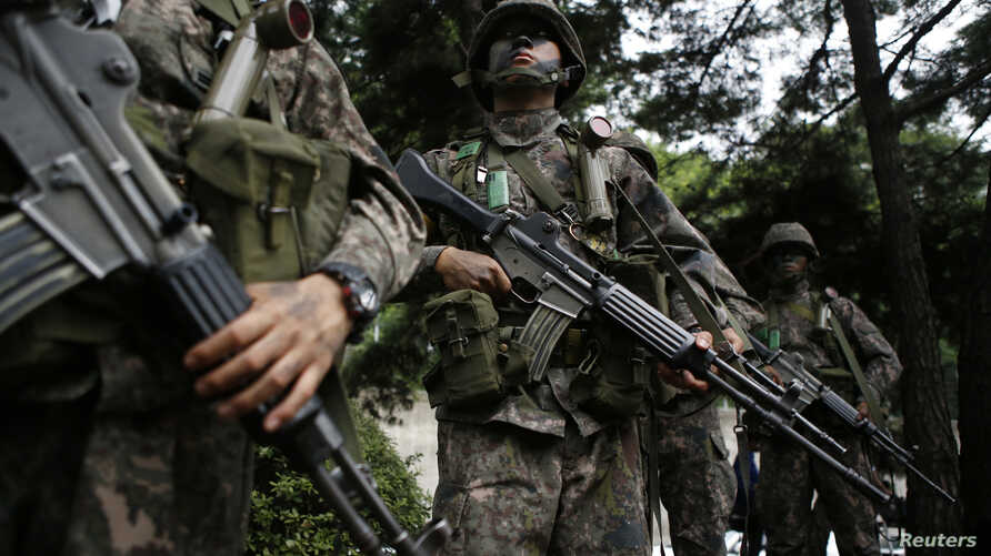FILE - South Korean soldiers take part in an anti-terror drill in Seoul, Aug. 18, 2014.