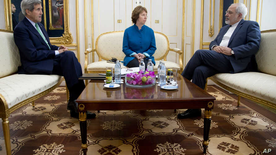 From left, U.S. Secretary of State John Kerry, European Union High Representative Catherine Ashton and Iranian Foreign Minister Mohammad Javad Zarif hold a trilateral meeting in Vienna, Austria, Oct. 15, 2014.