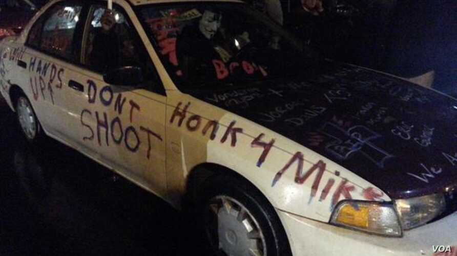 A car parked outside police headquarters in Ferguson, Missouri, carries its own messaging, conveyed via a reporter's tweet, on Nov. 21, 2014.