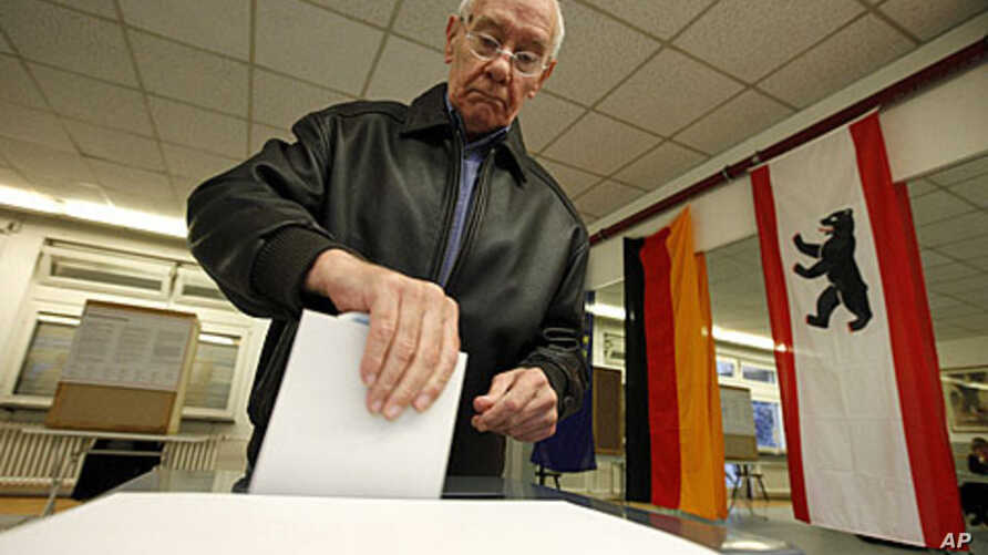 A man casts his vote in the city-state election at a polling station in Berlin September 18, 2011.