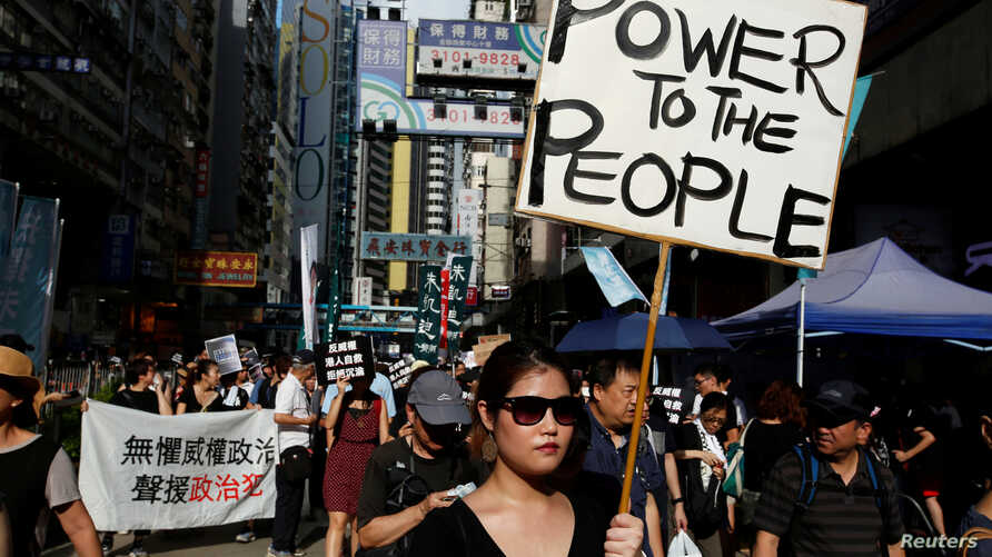Pro-democracy activists take part in a protest on China's National Day in Hong Kong, China, Oct. 1, 2017.