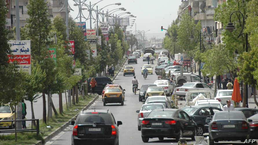 Cars drive on a street on May 7, 2014 in a government-controlled district of Homs.