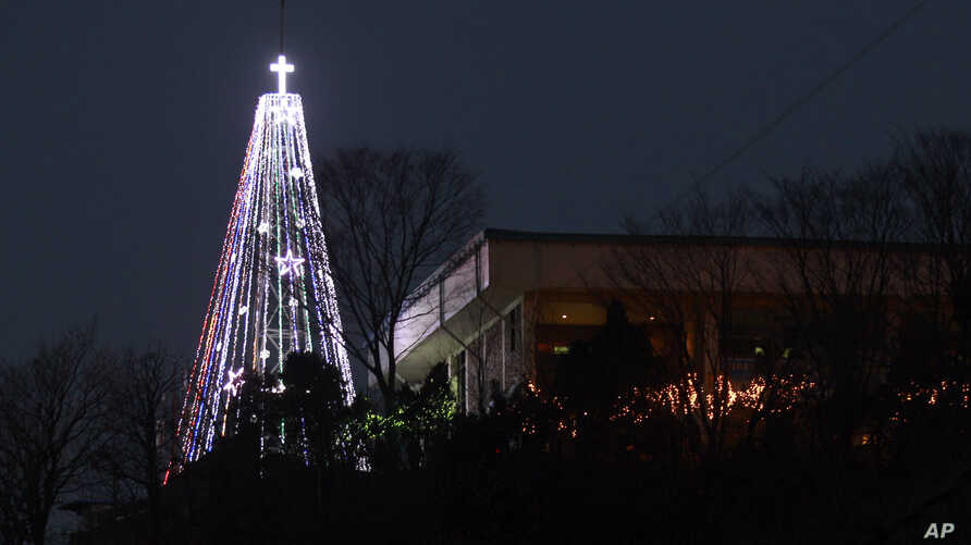 FILE - A giant steel Christmas tree lit up at the western mountain peak known as Aegibong in Gimpo, South Korea, Dec. 21, 2010.