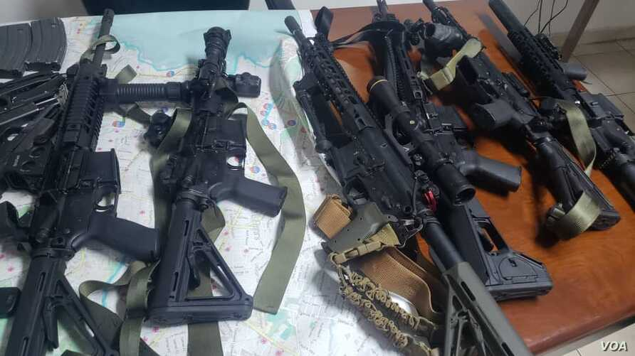 "Some of the weapons seized by Haiti's national police force officers (PNH) Sunday after arresting 8 men who are charged with ""conspiracy""."