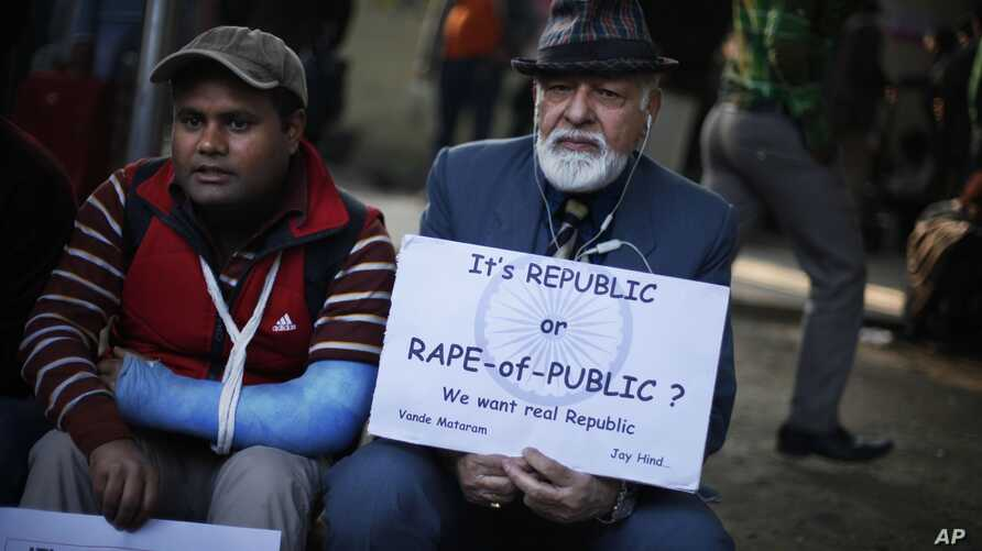 An elderly Indian participates in a protest against gender discrimination and sexual violence in New Delhi, India, Jan. 26, 2013.