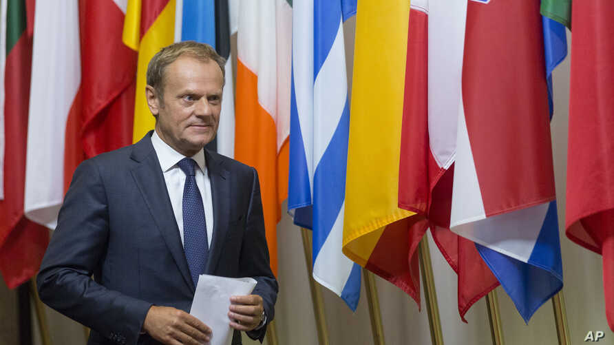 European Council President Donald Tusk prepares to address a media conference at the EU Council building in Brussels on June 24, 2016.
