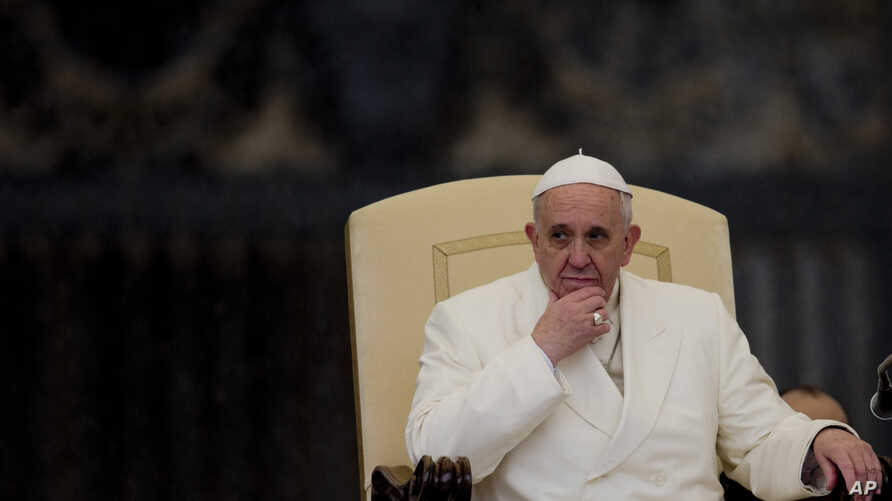 Pope Francis listens to his speech being translated in several languages, during his weekly general audience in St. Peter's Square at the Vatican, Feb. 5, 2014.