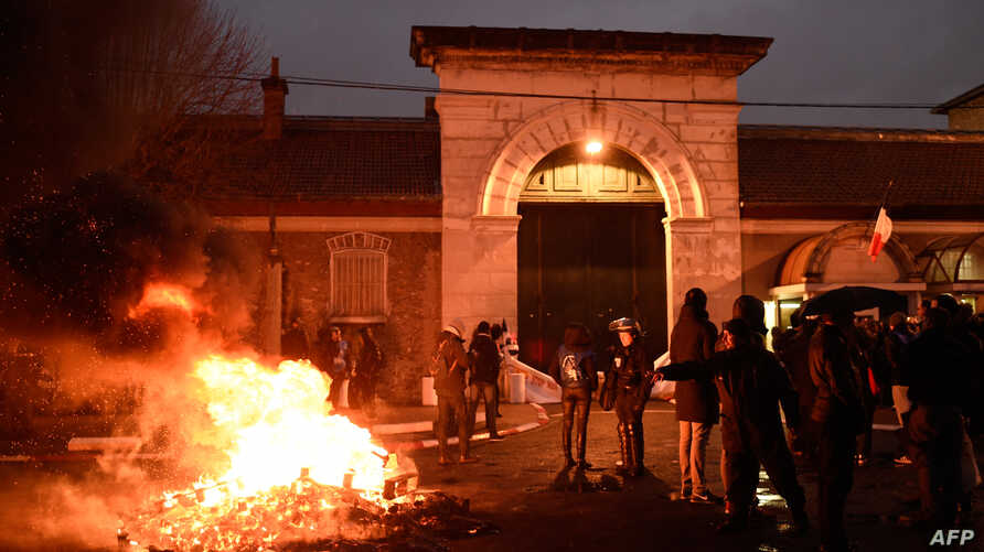 Wooden pallets burn as prison guards block access to Fresnes prison, Jan. 16, 2018, to demand tighter security after three officers were injured in an attack by Christian Ganczarski, a German terror convict. Ganczarski is serving an 18 year sentence