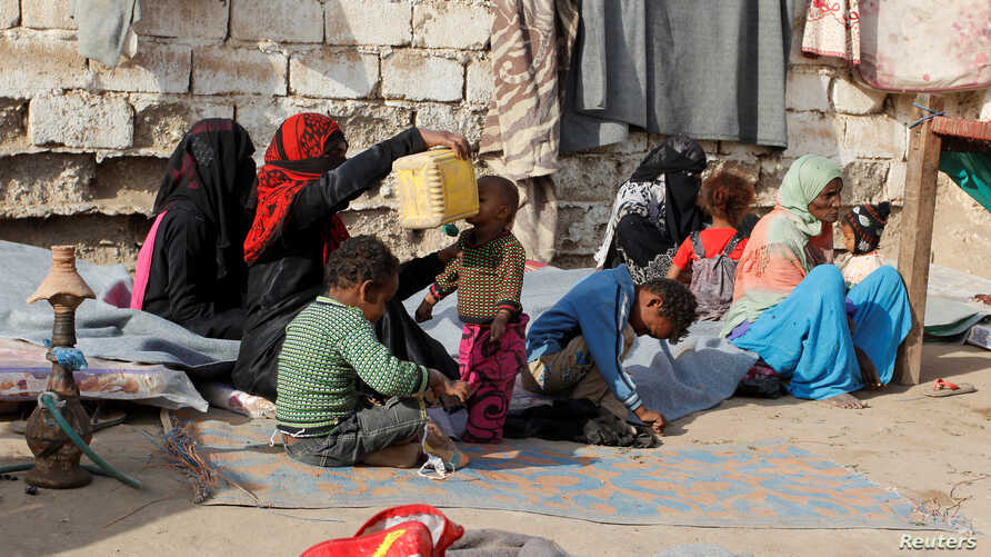 Internally displaced people sit at a makeshift camp for IDPs in al-Jarahi, south of the Red Sea port city of Houdieda, Yemen February 22, 2017.
