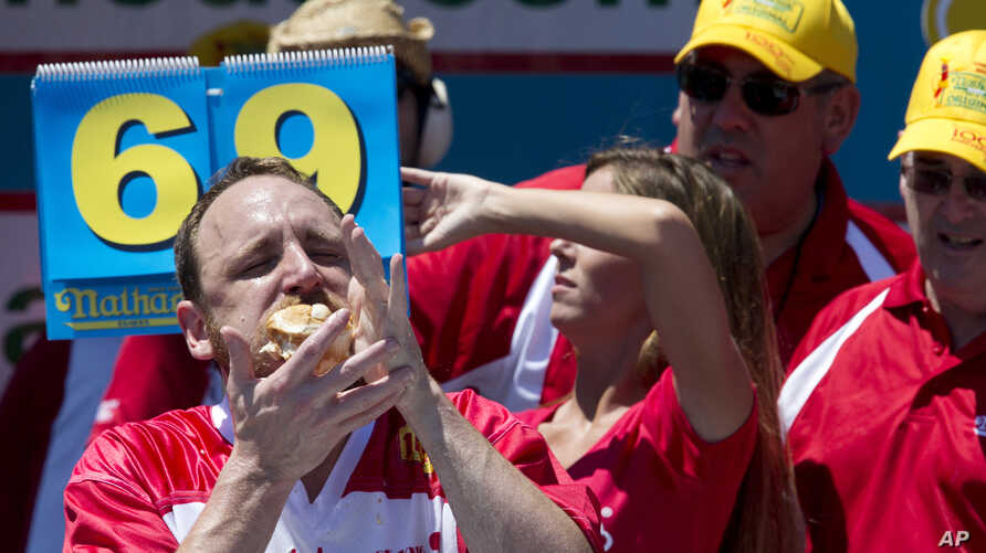 Joey Chestnut competes in Nathan's Famous Fourth of July International Hot Dog Eating Contest men's competition in New York, July 4, 2016.