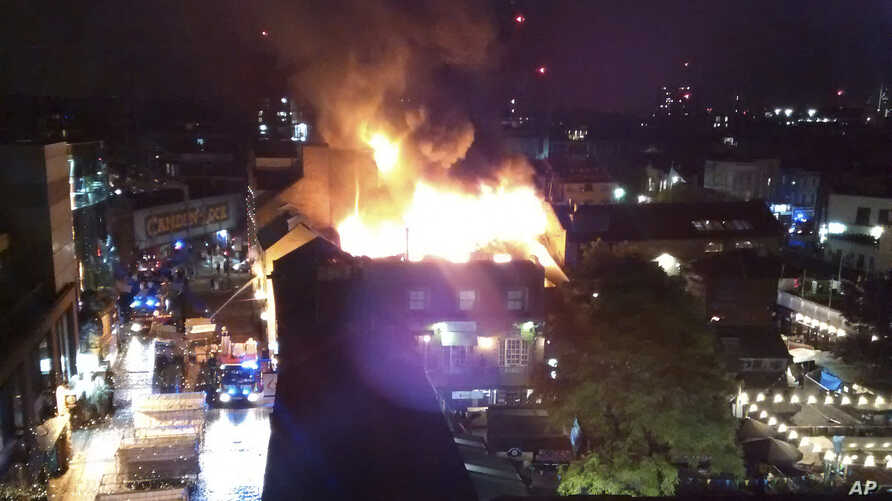 Flames and smoke rise from a fire affecting a small area of Camden Market in London, July 10, 2017.