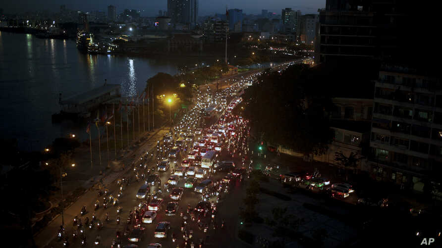 FILE - Traffic moves besides the Saigon river during rush hour in Ho Chi Minh City, Vietnam, Nov. 18, 2015. Senior officials warn air pollution levels in Ho Chi Minh City and Hanoi alone could soon match the deteriorating air quality of Beijing.