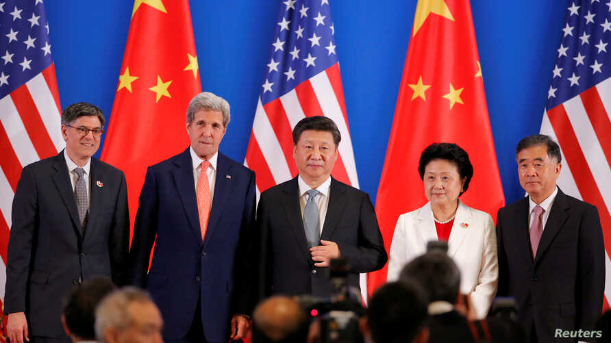 (L-R) U.S. Treasury Secretary Jack Lew, U.S. Secretary of State John Kerry, China's President Xi Jinping, China's Vice Premiers Liu Yandong and Wang Yang, and State Councilor Yang Jiechi pose for photo during the joint opening ceremony of the 8th rou