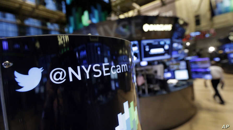 An updated phone post on the floor of the New York Stock Exchange features a Twitter logo, Nov. 4, 2013, in New York.